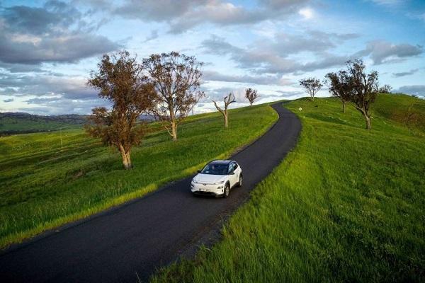 A car driving through a rural area