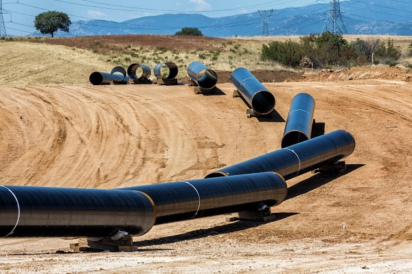 Giant pipelines lined up on the road